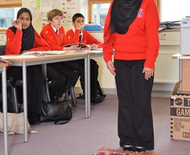 student preparing to pray in religious studies lesson