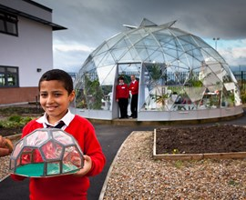 boy with model geodesic dome